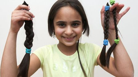 Jenna Haji with plaits of her hair. Picture: Nigel Sutton.