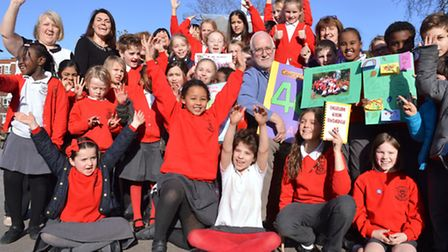 School-keeper Ron Holding celebrates 40 years at St Paul's Primary School in Primrose Hill with pupi