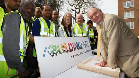 Former Major of London Ken Livingston leaves his handd prints for prosperity at the opening of the