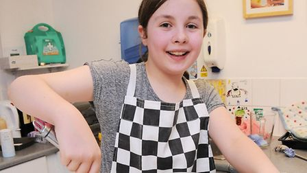 Year 6 pupil Robyn Aaron prepares some salad. Picture: Dieter Perry