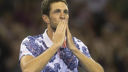 Great Britain's James Ward celebrates defeating USA's John Isner during the Davis Cup match at the E