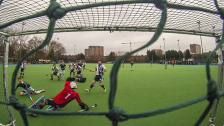 Reading's Ben Boon (far left) deflects the ball into the roof of the net past the diving Hampstead a