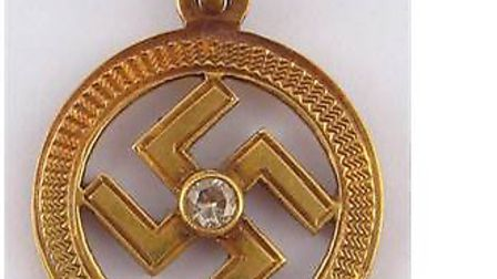 The swastika pendant was being auctioned at Hampstead Auctions.