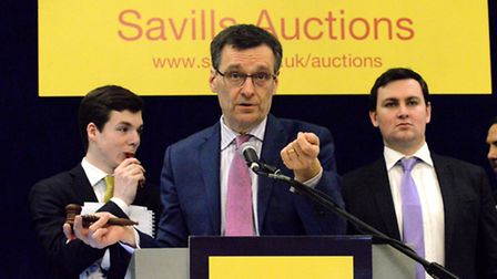 Auctioneer Chris Coleman-Smith in action at Savills London auction 17th Feb, 2015