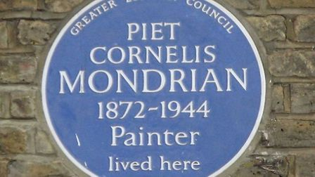 The blue plaque outside the building