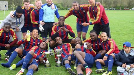 FC Bartlett celebrate with the Albert Daniels Cup. Pic: Dave Simpson/TGSPHOTO