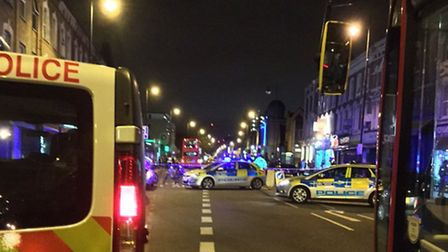 Police attend the scene of the shooting in Stoke Newington Road. Photo Betzalel Just.