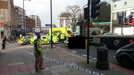 The elderly woman receives treatment after being involved in the collision in Finchley Road (image h