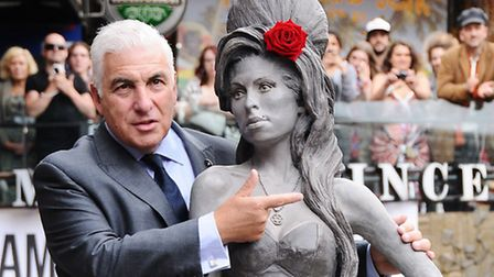 Mitch Winehouse next to the statue of his daughter unveiled in Camden Market last year. Picture: Die