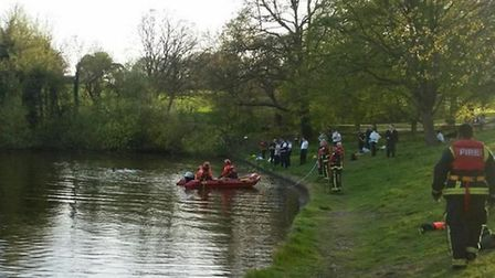 Firefighters tried in vain to locate a body in the men's bathing pond in Hampstead Heath. Picture: T