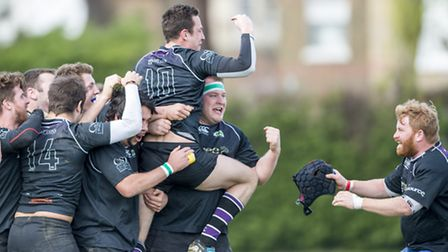 Belsize Park's third team celebrate their latest promotion. Pic: davidwphotos.co.uk