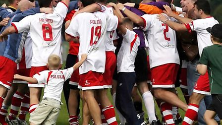 The Poland team celebrate victory in a group match at the Inner City World Cup