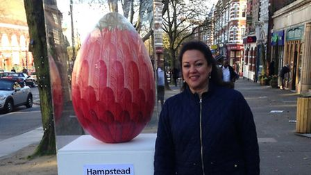 Jessica Learmond-Criqui with the giant egg in Haverstock Hill