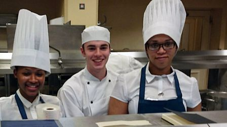 Nerissia Wallace (18) and Melisa Costa (23) in the Palace kitchen with a member of the Palace staff
