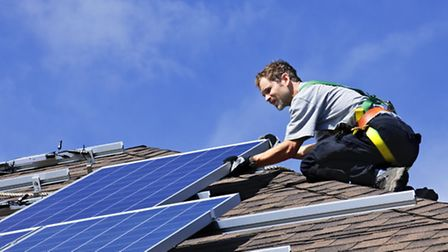 Solar panels being fitted. Picture: PA Photo/thinkstockphotos.