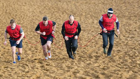 Steve Henry with friends doing the Marathon des Sables in the Sahara Desert
