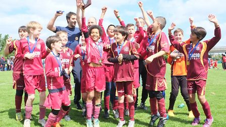 Stoke Newington Under-11 Reds celebrate with the Ken Grant Cup