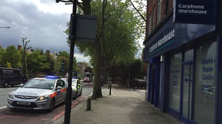 Police on the scene outside Carephone Warehouse in Finchley Road after the robbery