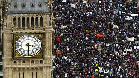 LONDON - FEBRUARY 15: Several hundred thousand people march past the Westminster Clock Tower (Big B