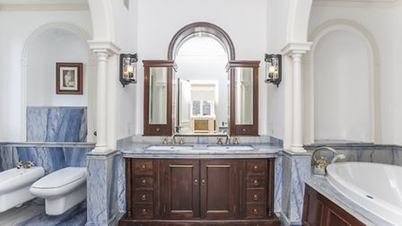 The master bathroom featuring jade, onyx, amethyst, blue and white marble and mahogany