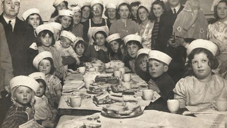 Irene (end of the back row) hosting a party for children during the war