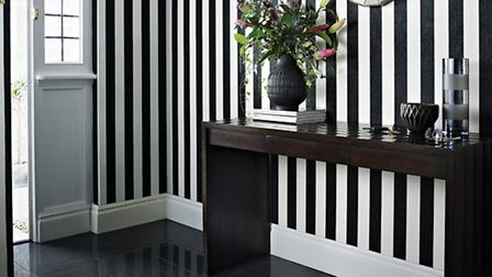 Glitterati black and white stripe wallpaper by Julien Macdonald, available from Graham and Brown. PA