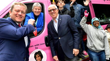 Jon Culshaw hands over the keys to a new minibus to principal Kay Bedford OBE, with Malcolm Brenner