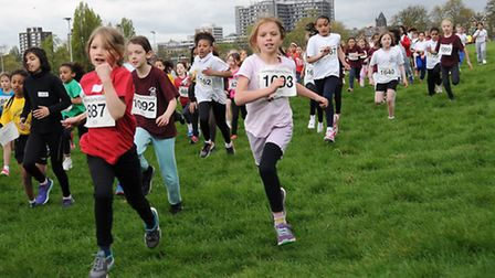 Young runners race away from the start line in the Camden Schools Cross Country Championship at Parl