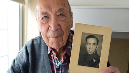 Geoffrey Janes (90) with a photograph of himself in uniform in 1946, when he was Sgt Janes of the Ro