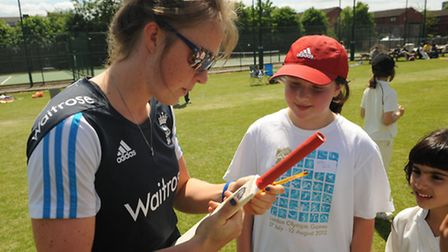 England's Becky Grundy signs an autograph for Maddy Smith from Kentish Town at Hampstead CC