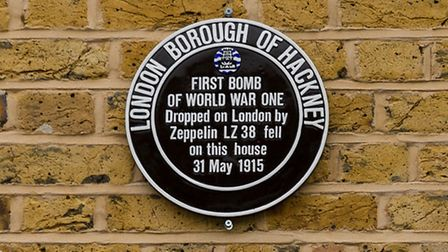 The new plaque at the unveiling of a new plaque at a house in Alkham Road, commemorating the first W