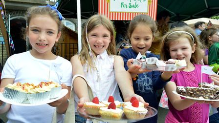 From left Amelie, Ella, Sophie and Emily show off their cakes.