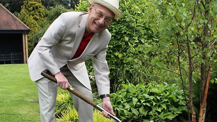 Jeremy Simons plants a tree in Golders Hill Park