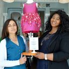 Maria Marquez, shop volunteer at Mary's Living and Giving in Primrose Hill, and Erica Charles, chief