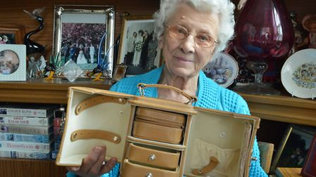 Edith Sell, 99, with the jewellery box emptied by the thieves. Picture: Polly Hancock