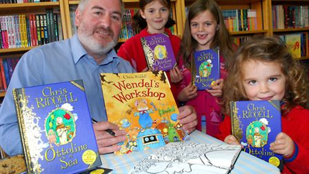 Author Chris Riddell signs copies of his books at Muswell Hill Children's Bookshop. Picture: Polly H