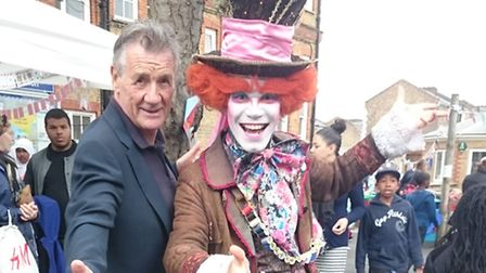 Carlton Primary School patron Michael Palin with the Mad Hatter at the annual summer fair