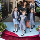 A parent and pupils take to the red carpet during the school run.