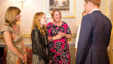 Prince Harry meets Flynne. Picture by Holly Clark