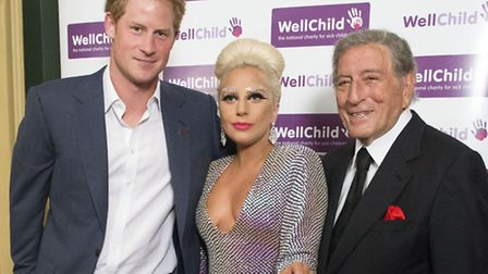 Prince Harry (left) meets with Lady Gaga and Tony Bennett as he attends a Well Child Charity concert