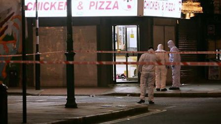 Forensic police officers investigate after Agnes Sina-Inakoju was shot at the Hoxton Chicken & Pizza