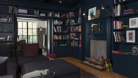 The library was painted in Hague Blue by Farrow and Ball. Picture: Matt Clayton Photography