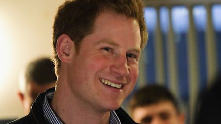 The solider is accused of selling stories about Prince Harry, pictured, and Prince William to tabloi
