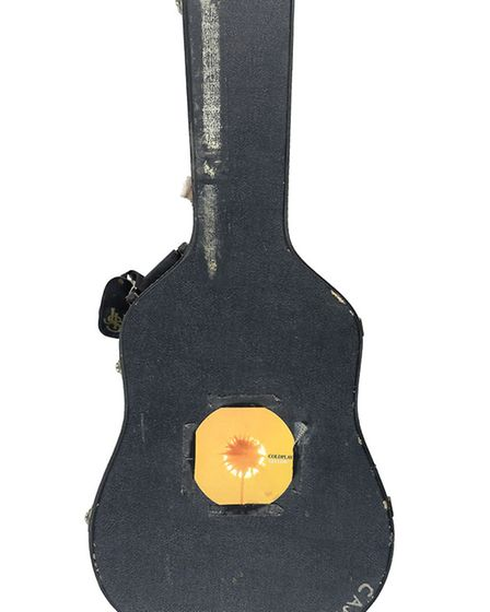 Chris Martin's first acoustic guitar sold for £18,750 at auction, more than doubling its top estimat