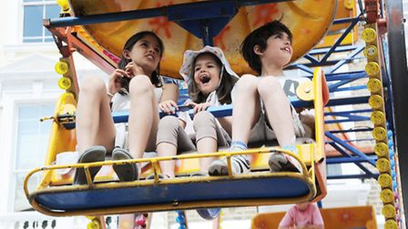 Children enjoy the fairground rides. Picture: Dieter Perry