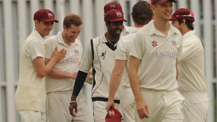 Highgate's Ed Foster (second from left) picked up four wickets against Middlesex Tamils Sports and S