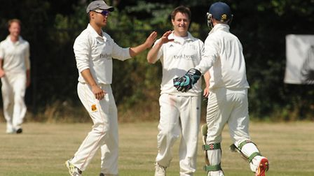 Rob Nelson (centre) took 4-19 as Brondesbury completed their victory by bowling Eastcote out for 150