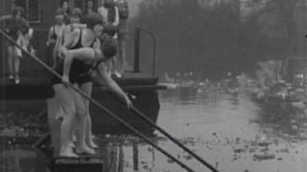 Women swimmers dive into an icy bathing pond on Hampstead Heath in 1931. Picture: Associated Press/M