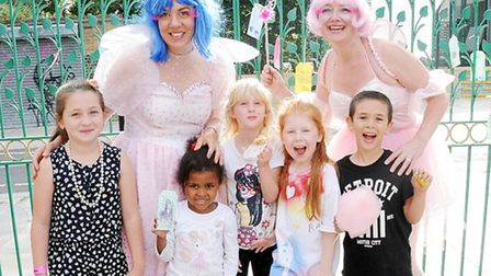Fairies Fay Ballard (left) and Willow Nash with children, from left, Lauren, 7, Victoria, 4, Arwen,
