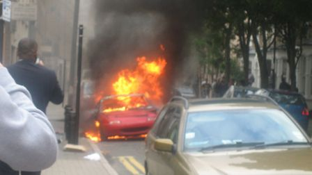 A car burning in Hackney Central during the riots. Photo Emma Bartholomew